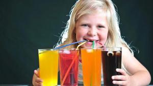 Kid drinking four sodas